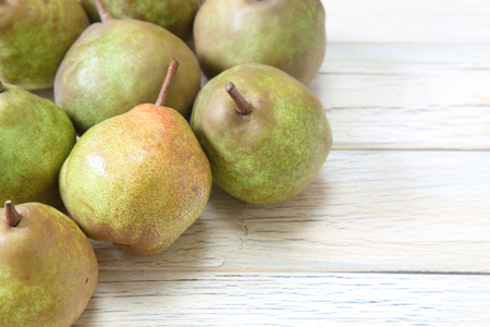 pears in a wooden background