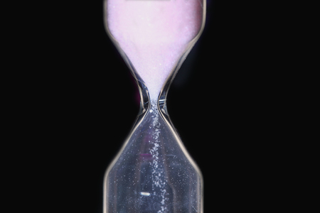 hourglass in a black background