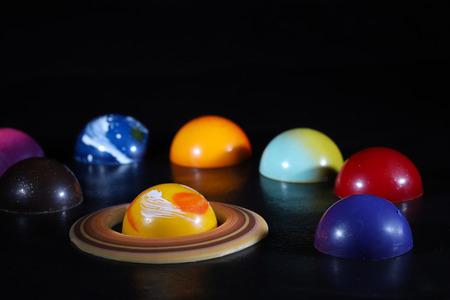 various kind of planet shaped chocolates Banco de Imagens - 118966774