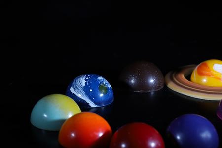 various kind of planet shaped chocolates Banco de Imagens - 118964483