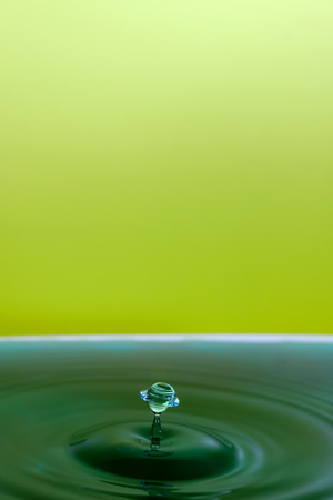 High speed photography of ripples and water drop.