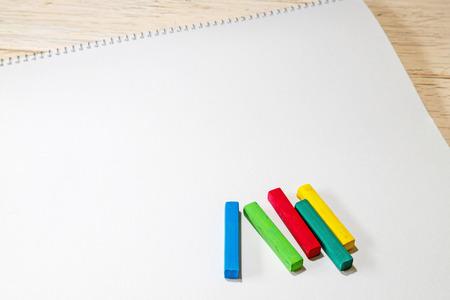 crayons on the blank sketchbook