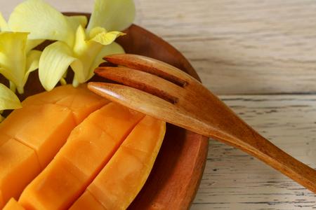 cut mango on a wooden background