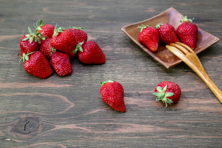 strawberries in a wooden background