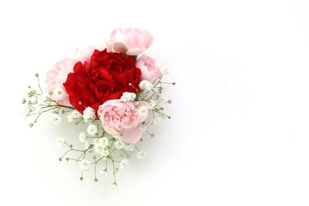 bouquet of roses and babys breath in a white background