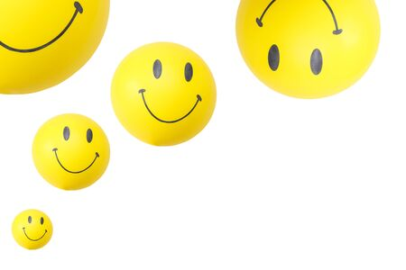 smiley shaped balloons in a white background Banco de Imagens