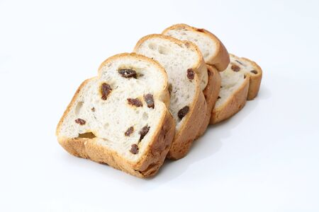 sliced raisin bread in a white background