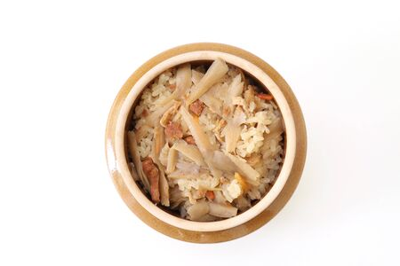 Kamameshi that is a Japanese dish in which rice, meat and vegetables are served in a small pot.