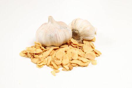dried garlics slice in a white background