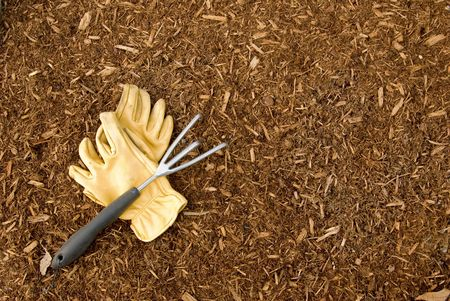Bark Mulch with Gloves and Rake Stock Photo