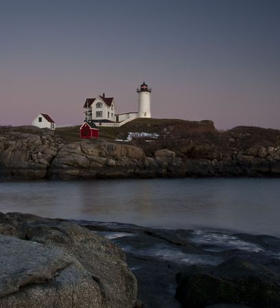 lighthouse at cape neddick main near sunset with christmas decorations stock photo picture and royalty free image image 4973621