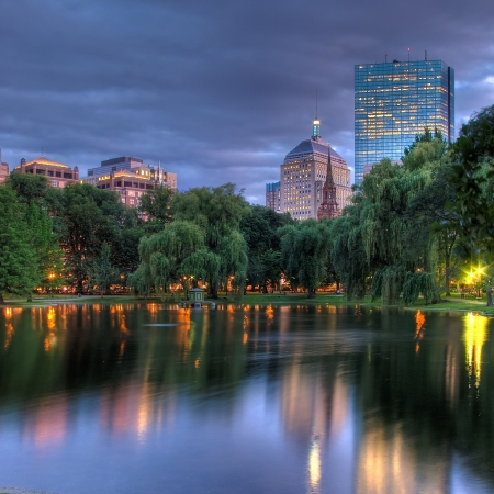 View across the Public Garden pond towards the Hancock Towers at Sunset