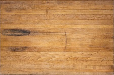 An aged butcher block cutting board suitable for backgrounds Banco de Imagens