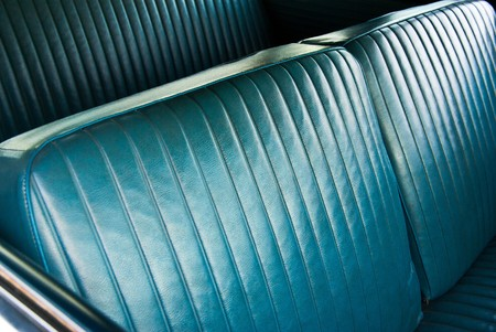 upholstery: Closeup view of the bench seat in an old cruiser.