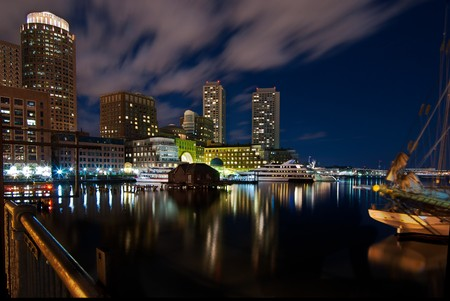 A night shot of the Boston inner harbor looking back towards downtown. photo