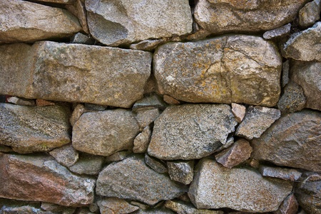 rubble: Close view of granite boulders stacked into a wall Stock Photo