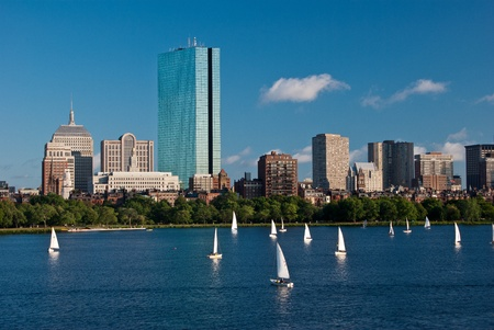 hancock building: Sailboats are in the foreground of a view of Copley Square as seen from across the Charles River