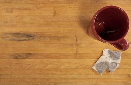 Tea bags sit next to a mug on a countertop photo