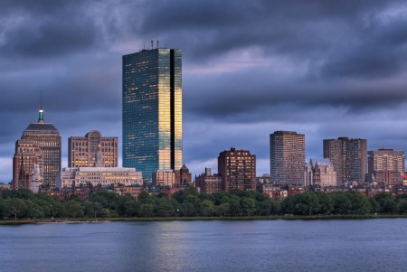 hancock building: Golden light illuminated the Boston Skyline viewed over the Charles River