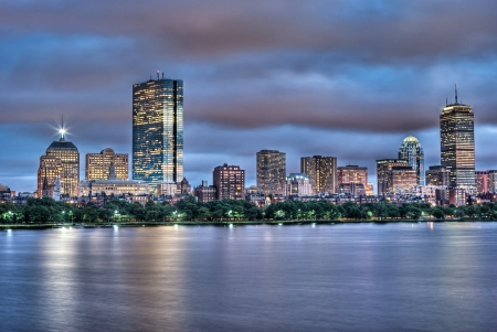 Night view of the Boston Skyline with brightly illuminated buildings photo