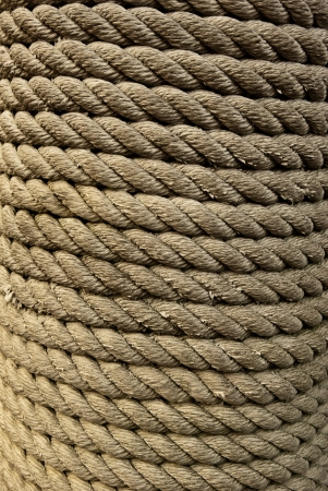 A closeup of hemp rope wrapped around a piling showing the texture Banco de Imagens