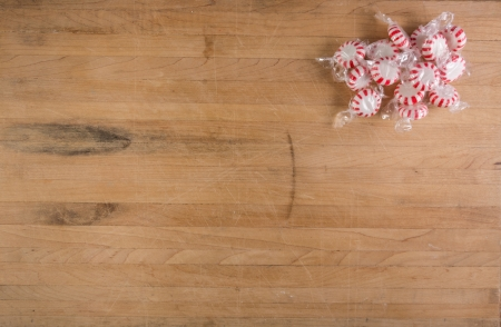 Group of peppermint candies sits on a worn cutting board Stock Photo - 16928765