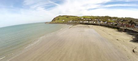 Ballygally Beach County Antrim Northern Ireland blue sky