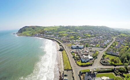Shore rd Ballygally County Antrim Northern Ireland Larne by Ballygally View Images blue sky Stock Photo
