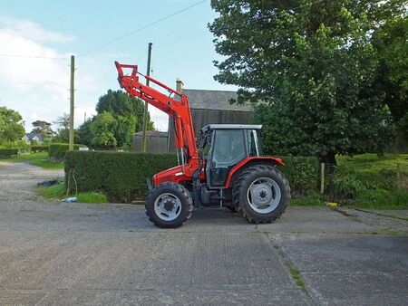 Red Tractor on Farmyard in Ireland 写真素材
