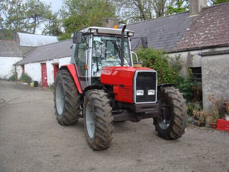 Red Tractor on Farmyard in Ireland 스톡 콘텐츠