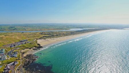 Portstewart Strand Beach with cars on sand and Atlantic ocean north Coast Co. Antrim Northern Ireland