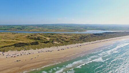 Portstewart Strand Beach with cars on sand and Atlantic ocean north Coast Co. Antrim Northern Ireland Reklamní fotografie