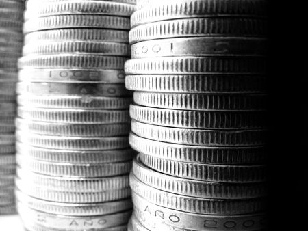 an ounce: A pile of coins Stock Photo