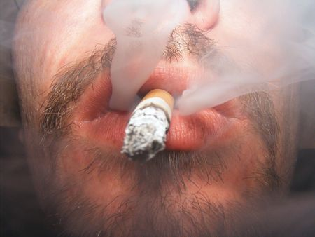 image of man smoking a cigarette Imagens