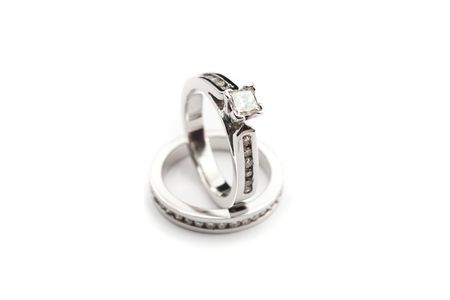 photo of diamond solitaire ring and channel set on white background, princess cut