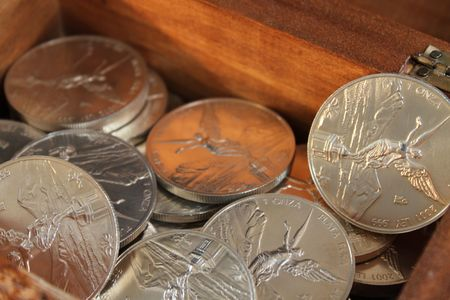 silver coins: fine silver coins from mexico named onza libertad Stock Photo