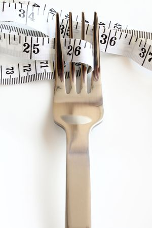 metaphor image of fork and tape measure on white background Imagens