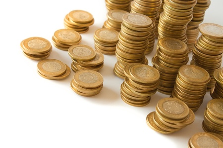 piles of golden coins on white background, mexican ten pesos coins photo