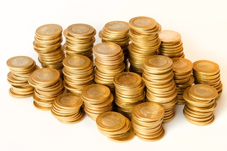 piles of golden coins on white background, mexican ten pesos coins