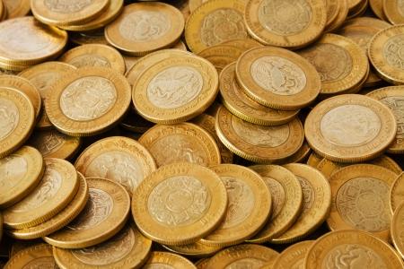 many golden coins background, mexican ten pesos coins
