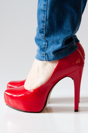 Sexy Shiny Red Female High Heels Shoes And Blue Jeans Stock Photo