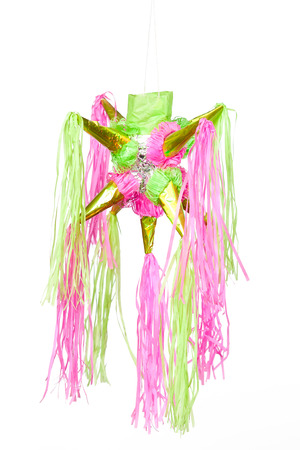 traditional pinata star shape from mexico isolated on white background, important part of parties and celebrations in mexican culture, very popular during posadas parties and independence day photo