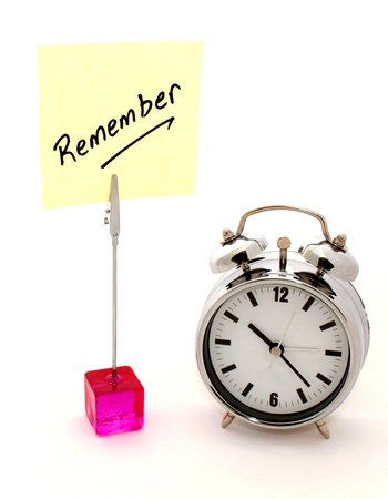 Remember, yellow note and clock Stock Photo