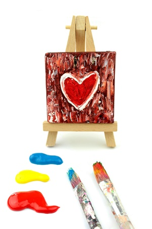 Heart Painting on easel  and  colors, paintbrush photo