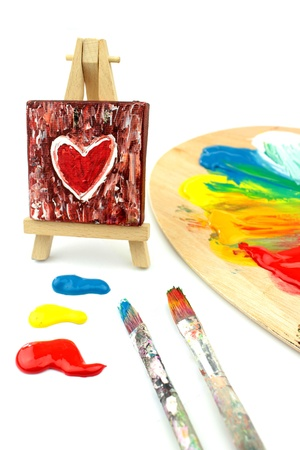 Heart Painting on easel  and  colors, paintbrush, pallet photo