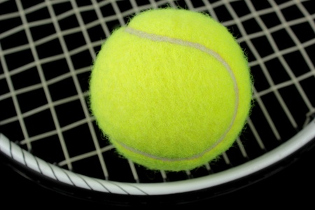 Tennis racket and tennis ball  photo