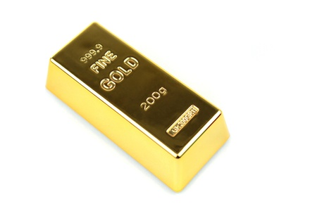 ingot gold on white background photo