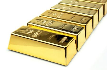 白い背景の上の金の延べ棒 写真素材