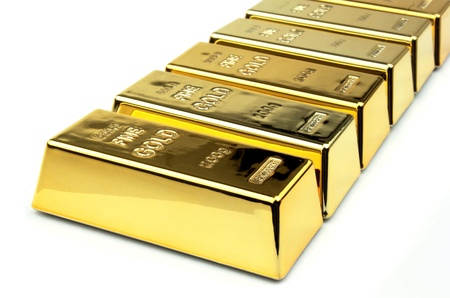 Gold bars on white background photo