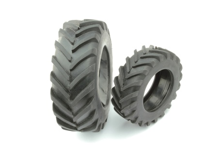 Tractor tires on white background photo